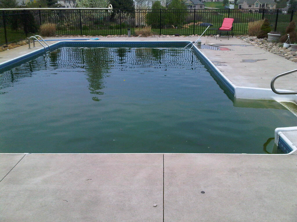 Opening a swimming pool in Michigan that has a safety cover