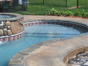 A gradual entry large step/sun shelf area on a vinyl liner pool. Not technically a beach entry area, but similar in concept and function, a great option for this homeowner in Novi, MI