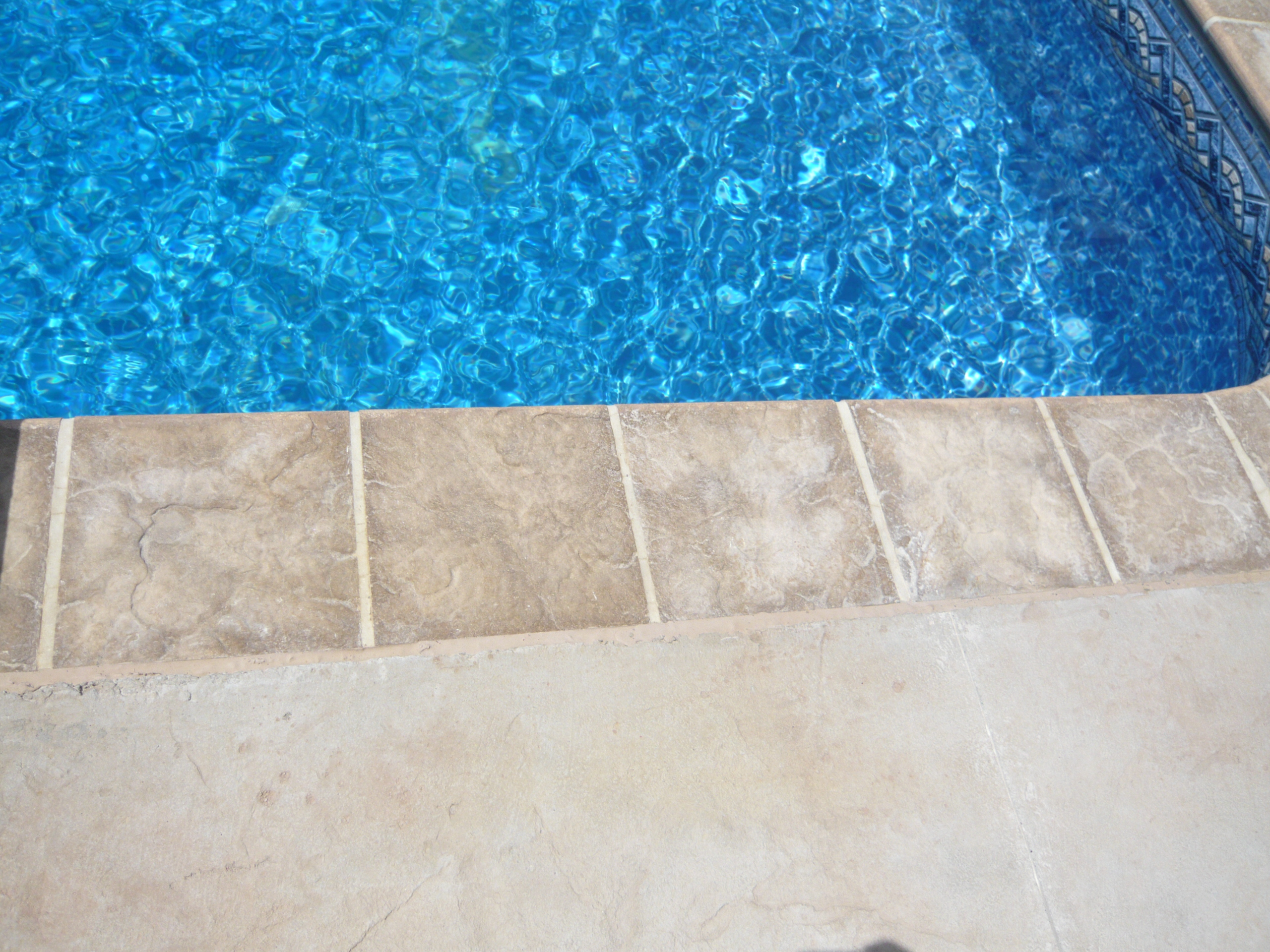 Stone Coping With Surface Mount Liner Track Installed