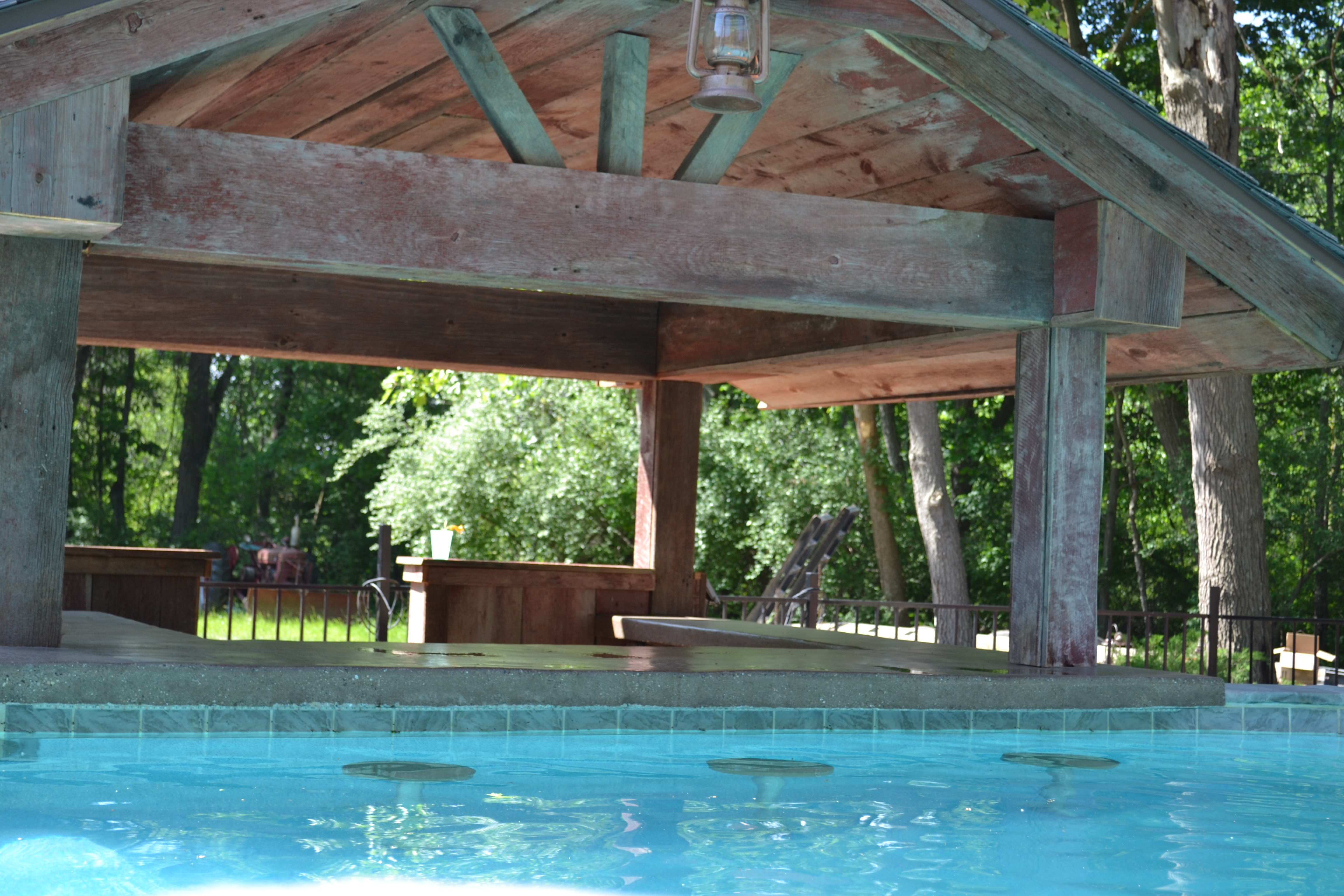 Swim Up Bar with Reclaimed Barn Timbers - Custom Michigan Swimming Pool by Legendary Escapes