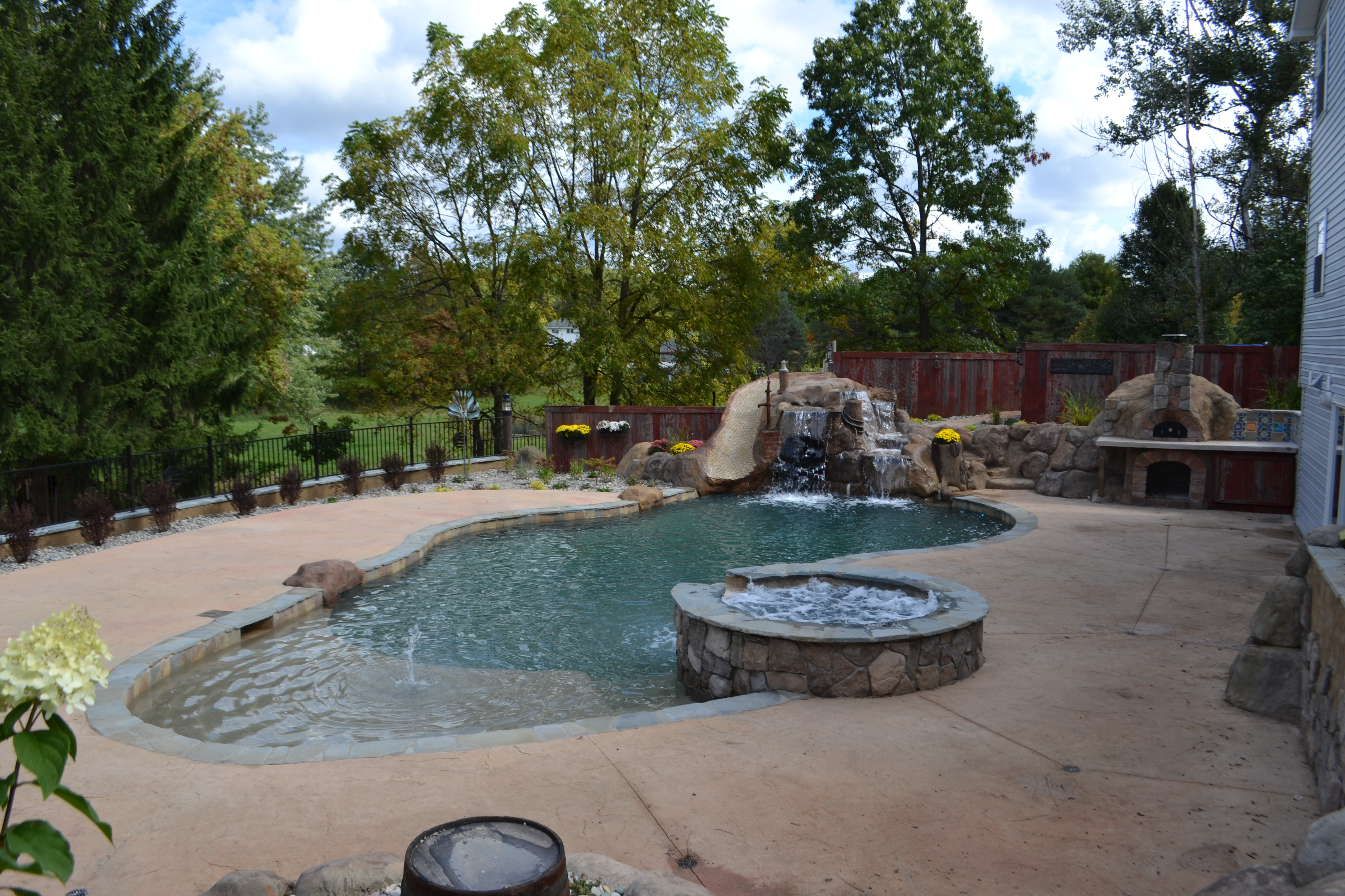 Nautical themed hybrid swimming pool with raised spa for Nautical themed backyard