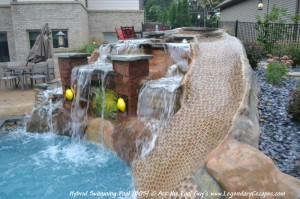 This custom, hand-carved waterfall and rock slide features beautiful lighting and a personalized mural.