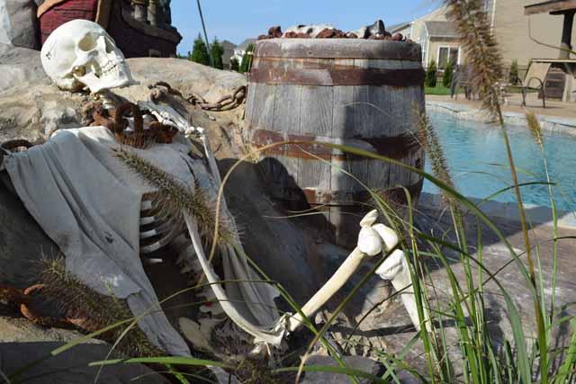 Pirate Captive Bones decorate the shoreline of a Legendary Escapes Pool